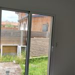 Photo projet : pose d'un baie vitrée coulissante avec ouverture par l'extérieur - vue par l'intérieur